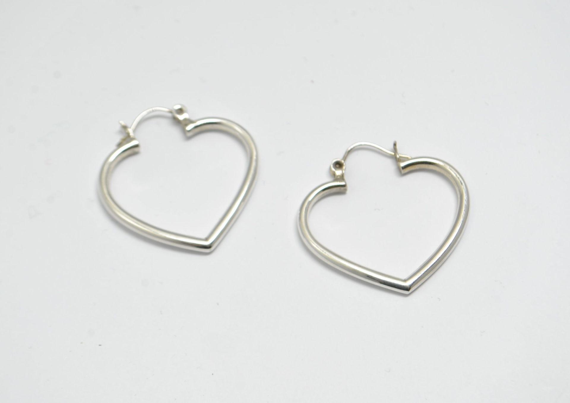 Boucles d'oreilles coeur fin en argent